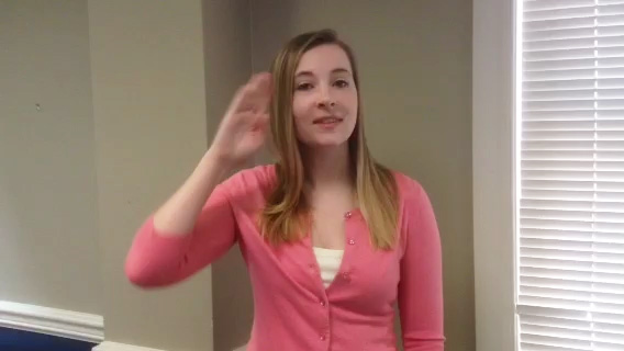 Cassie from HQ demonstrates proper framing for videos. Include the head and arms, but not a lot of wall space.