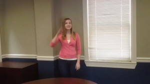 Cassie from HQ demonstrates incorrect video framing. There is a lot of blank wall space in the shot.